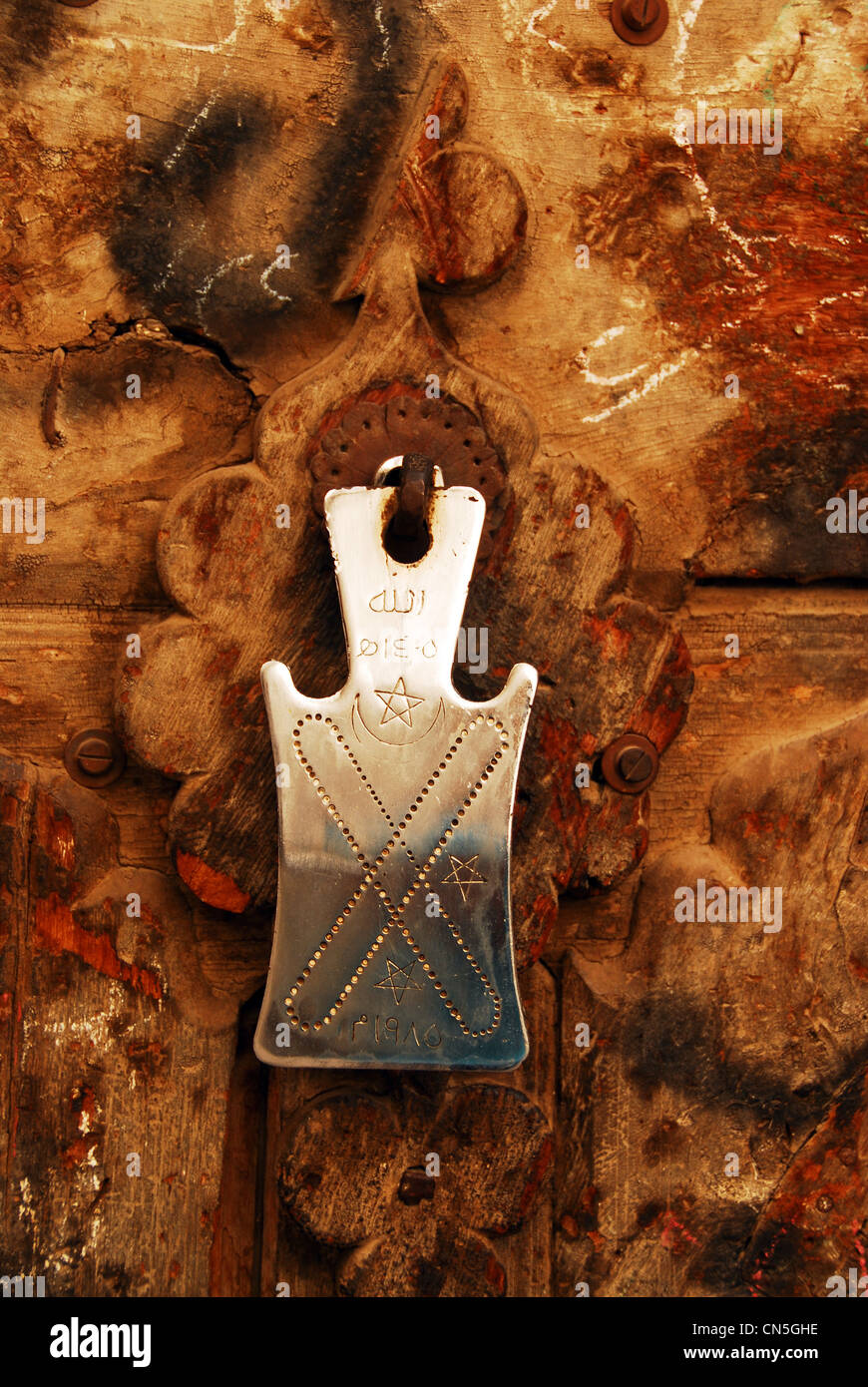 Yemen, Sanaa, old town listed as World Heritage by UNESCO, close-up of rusty closed old door - Stock Image