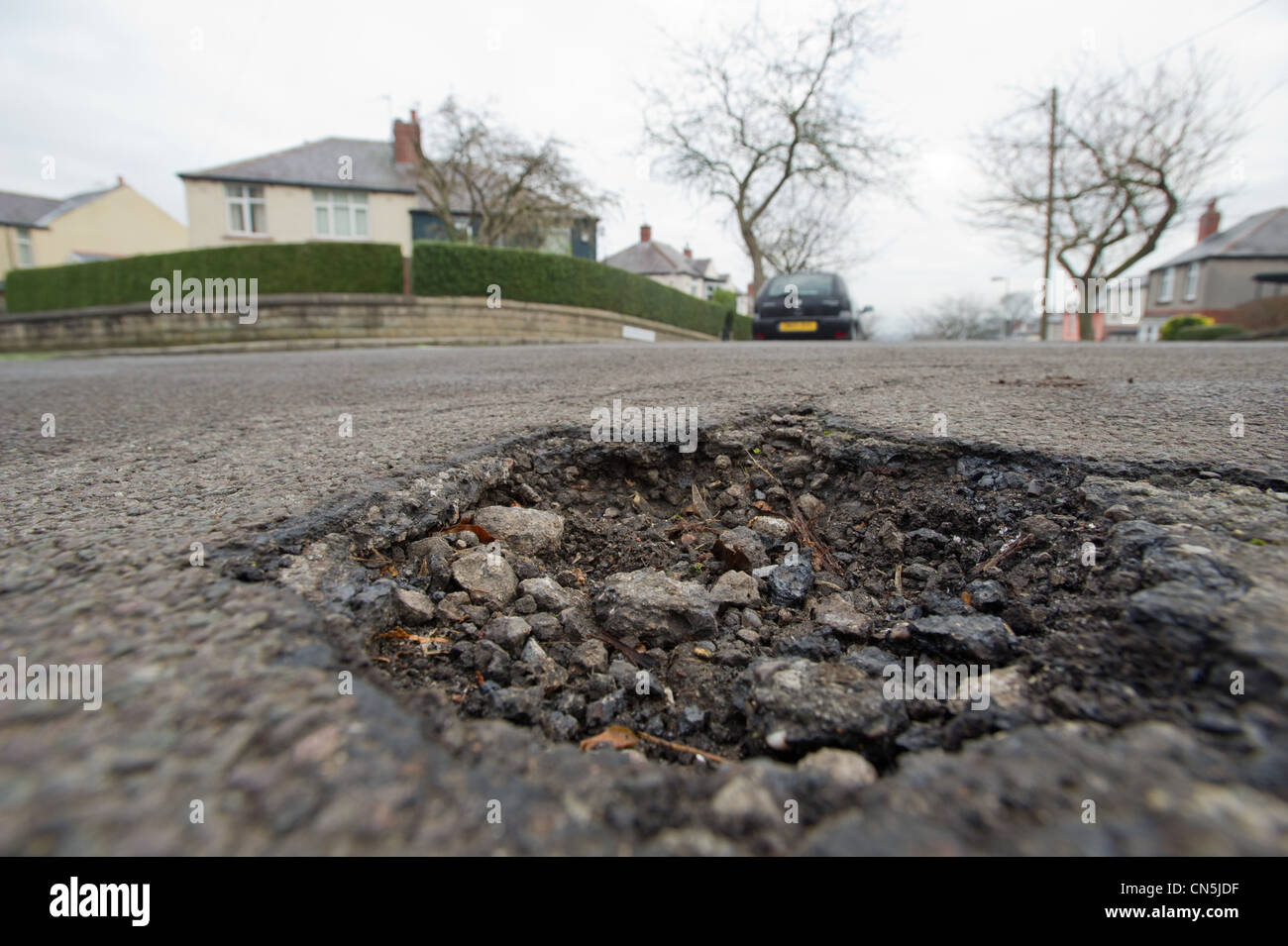 Potholes in the road - Stock Image