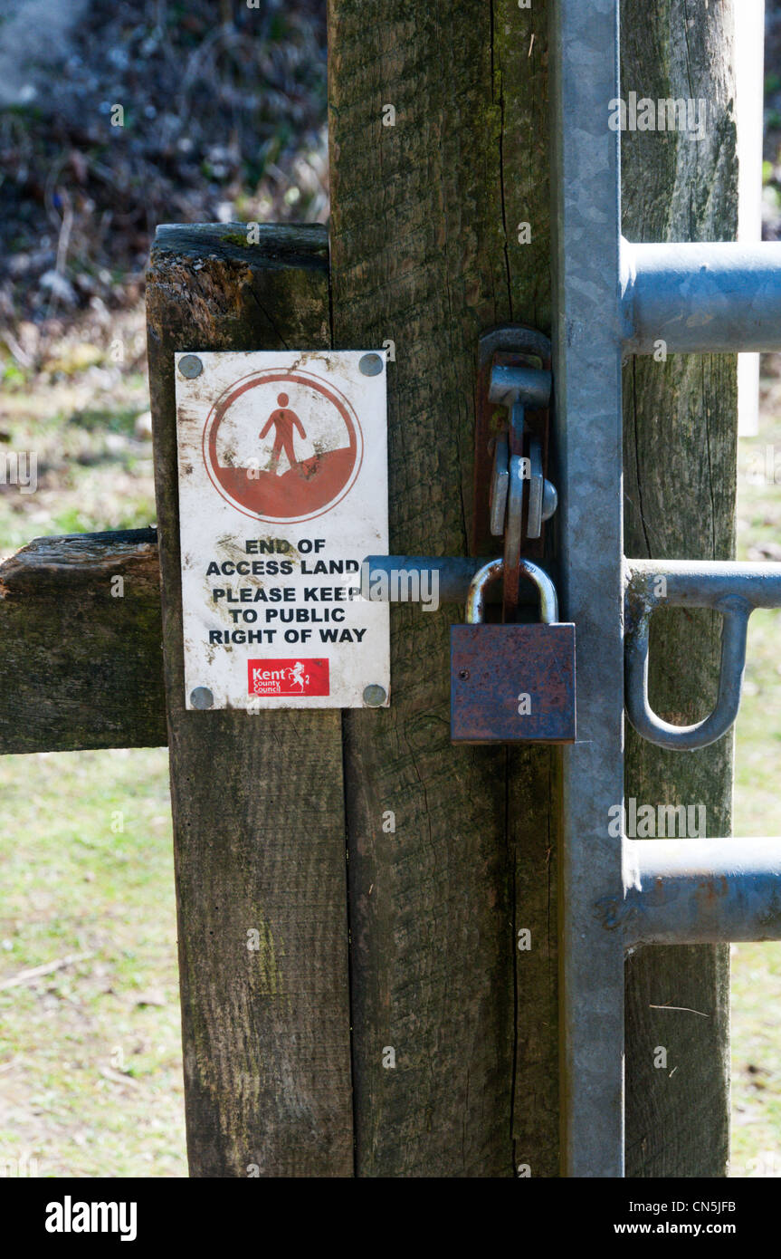 A sign marks the end of public access land and the start of a public footpath. - Stock Image