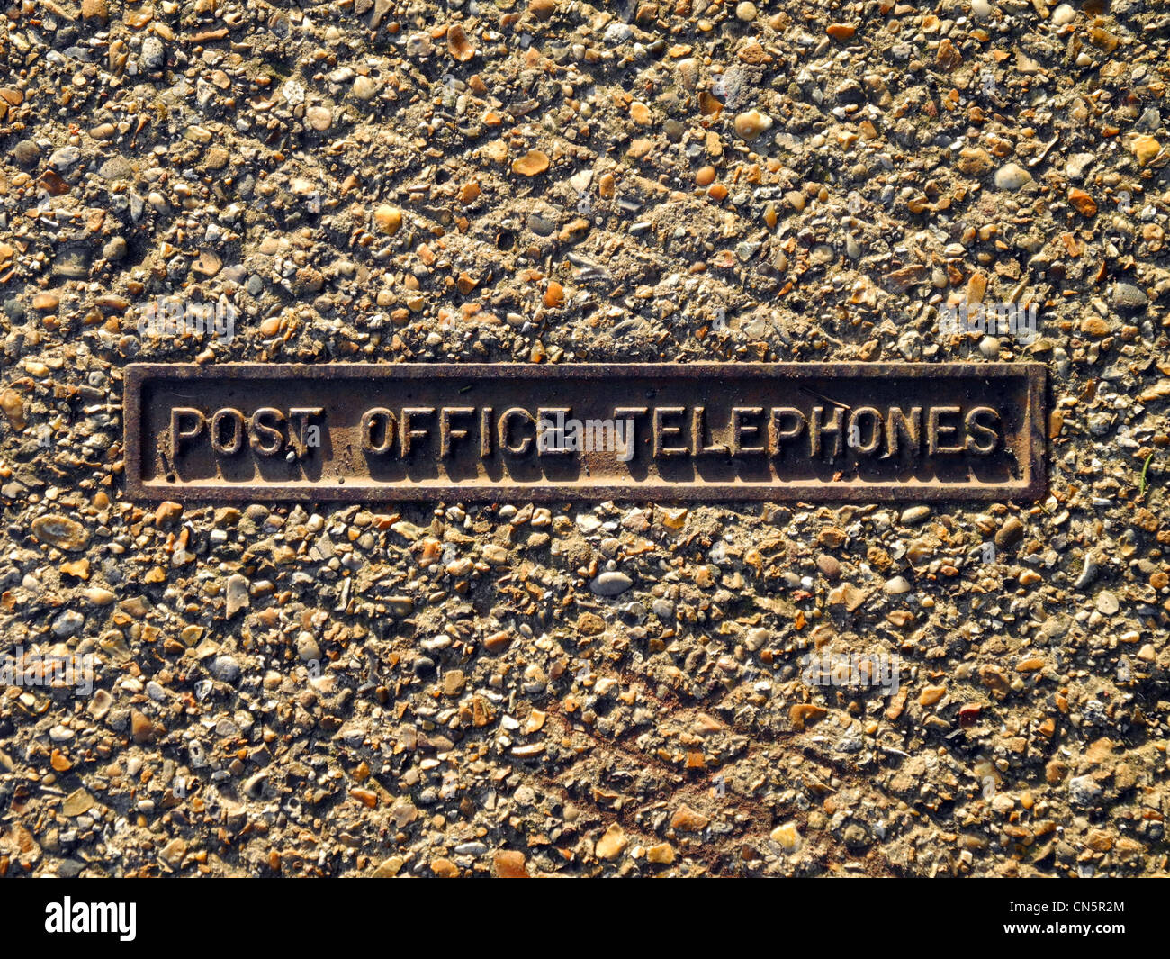 Old Post Office Telephones access cover in pavement - Stock Image