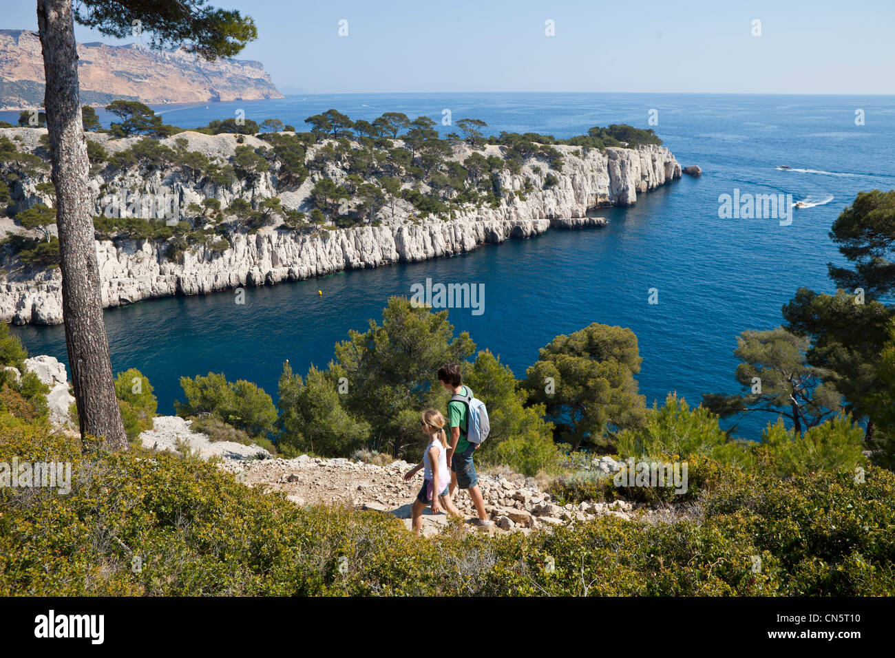 France, Bouches du Rhone, Cassis, the creek (Calanque) of Port Pin, children hiking Stock Photo