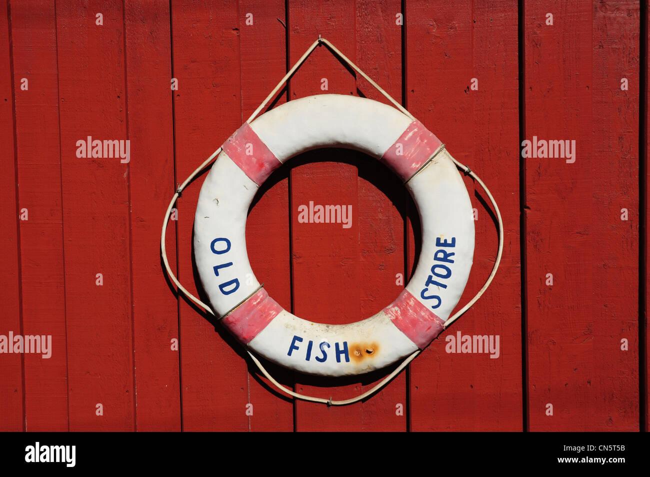 Lifebelt with name Old Fish Store, Lympstone, Devon, England, UK - Stock Image