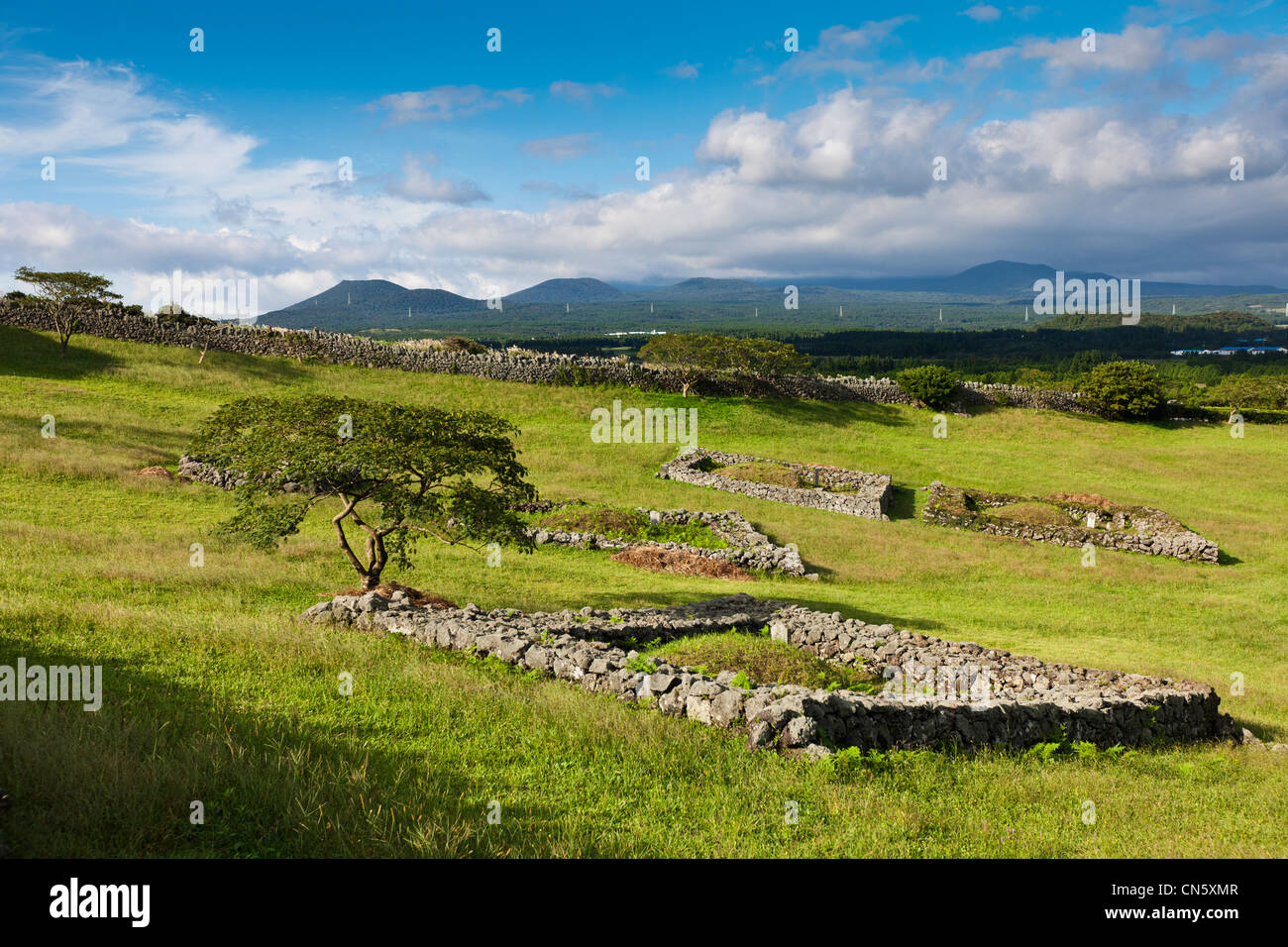 South Korea, Jeju Province, Seongeup, burial site in the bucolic landscape of Sangumbuli Stock Photo