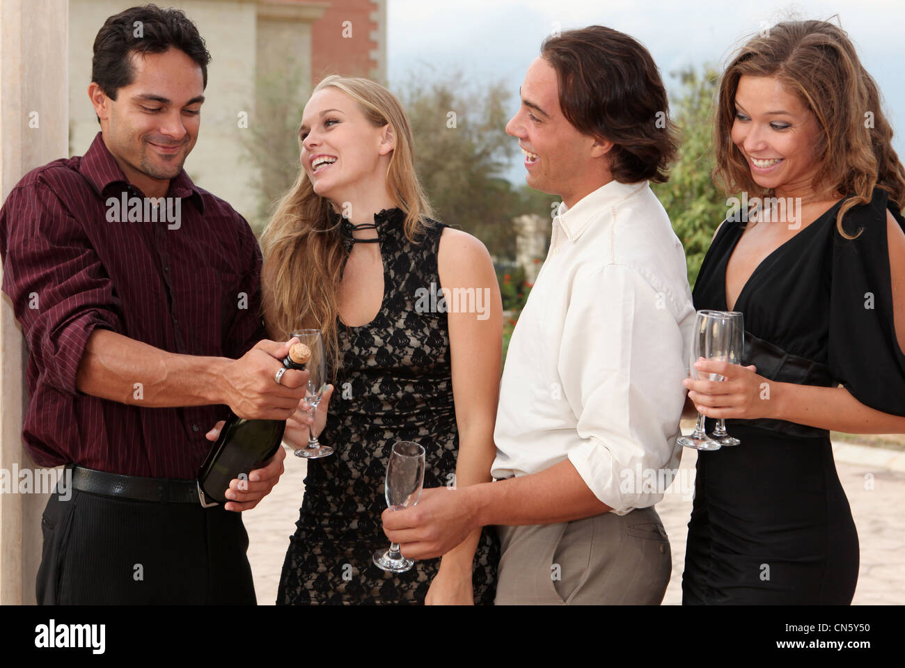 champagne party group - Stock Image