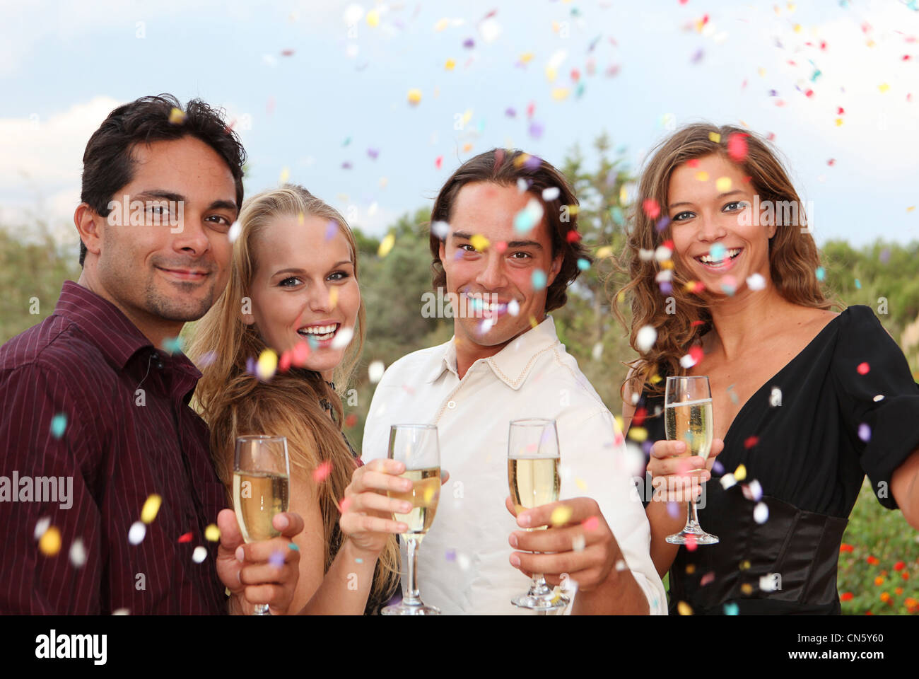 celebration party with champagne and confetti - Stock Image