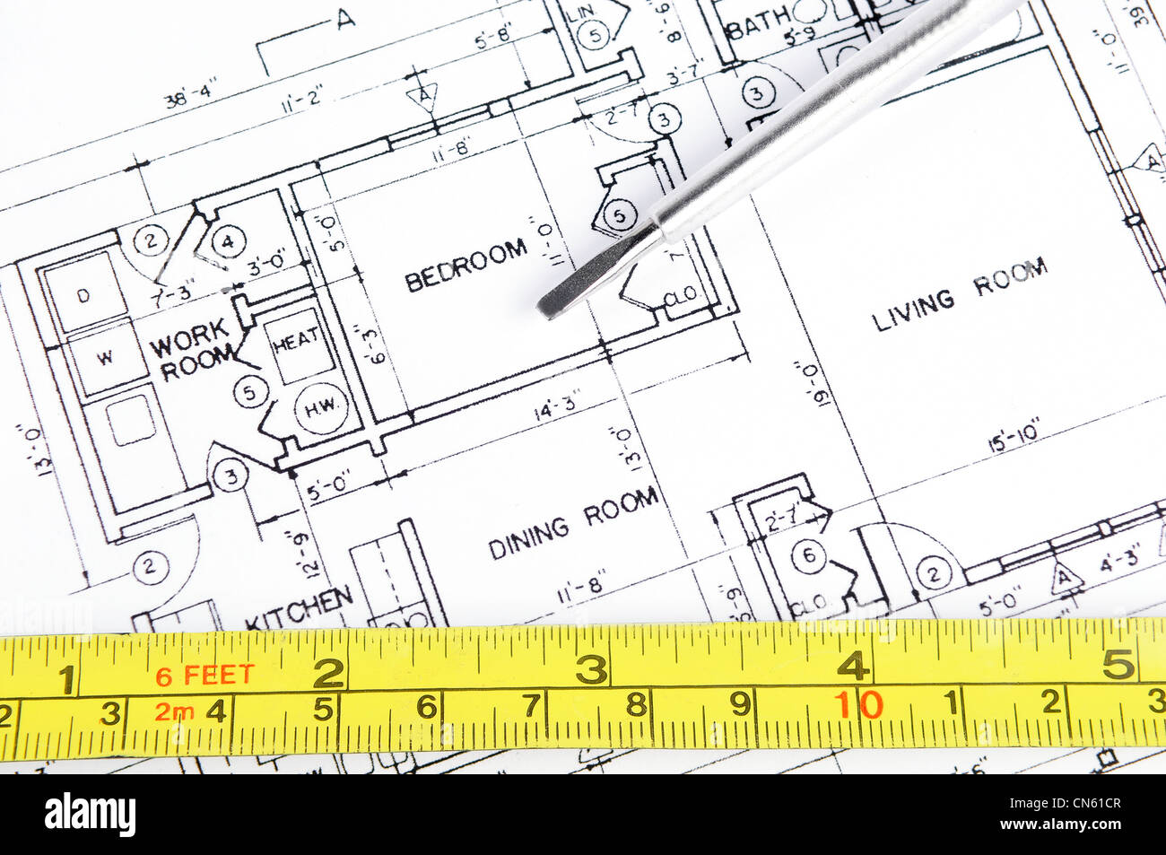 Excellent House Blueprint With A Measuring Tape And A Screwdriver On Top Of It Wiring Digital Resources Dimetprontobusorg