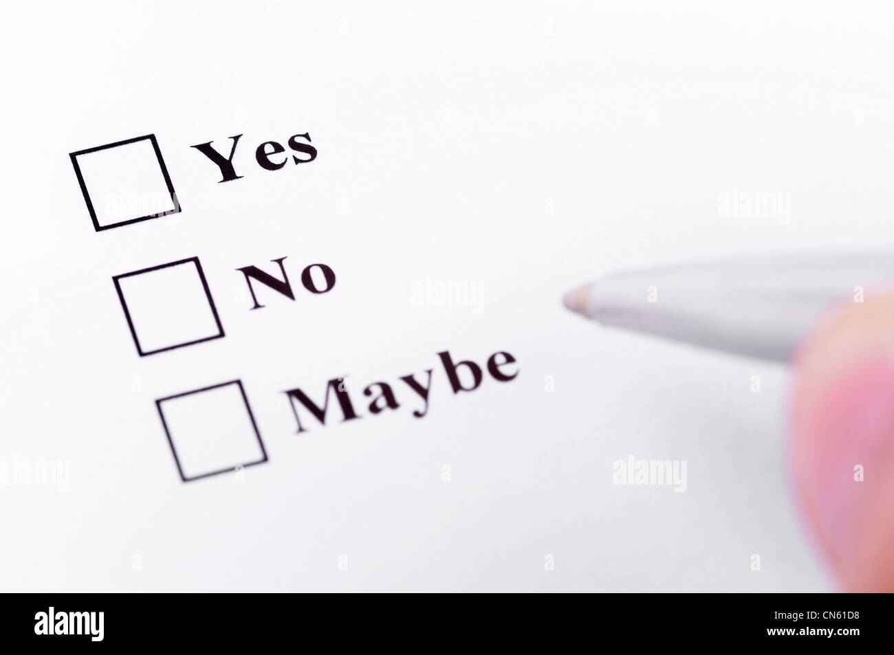 Making your decision. About to choose between yes, no, maybe. Stock Photo