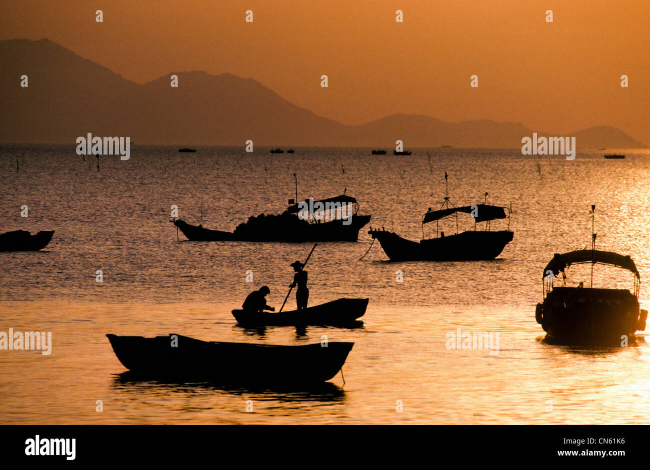 sampans at sunset in South China Sea off Hong Kong New Territories Coast China - Stock Image