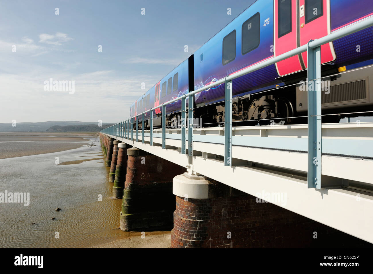 Train crossing the viaduct at Arnside Cumbria - Stock Image