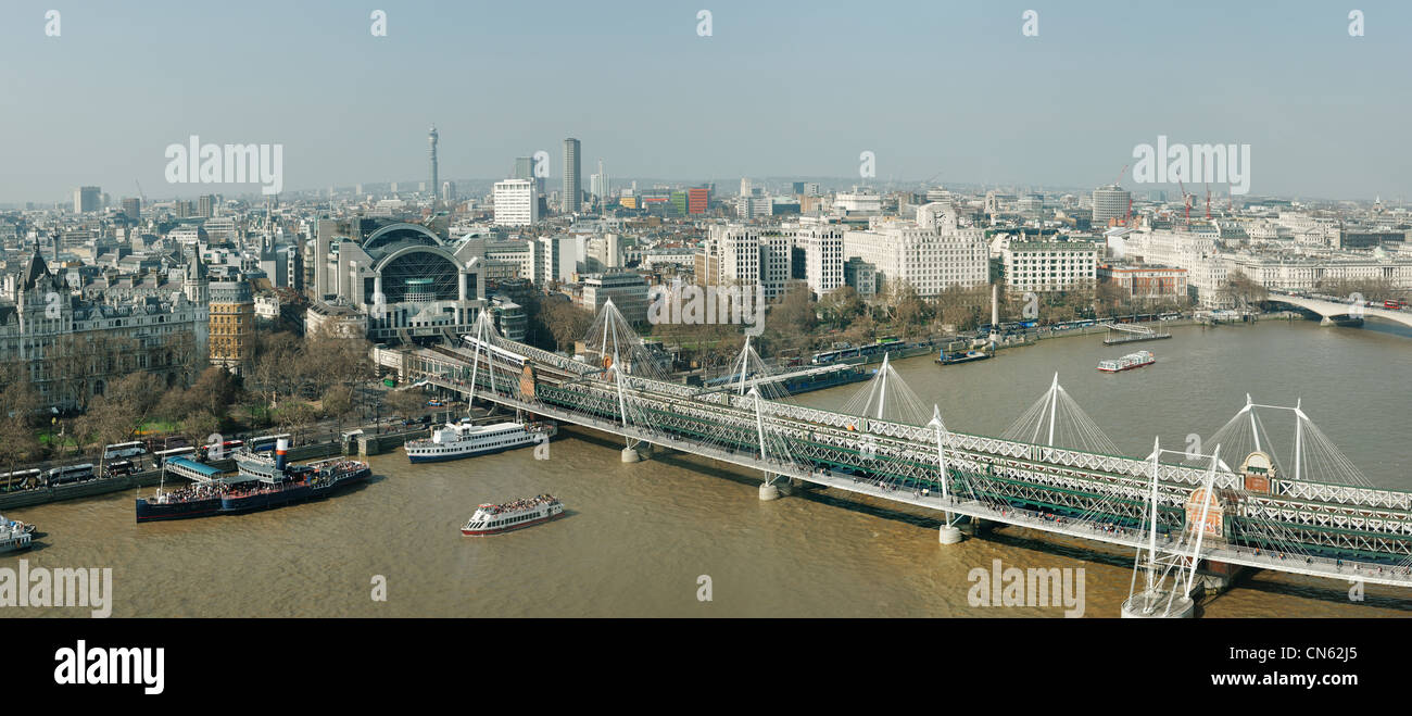 London panoramic skyline including Charing Cross Station and Hungerford Bridge - Stock Image