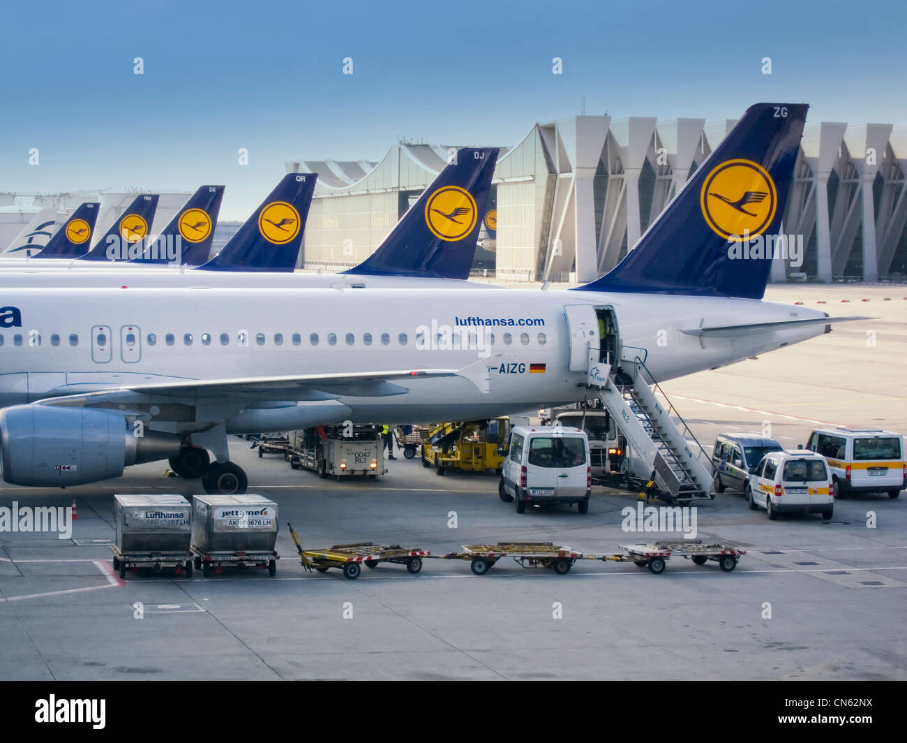 Rear part of several planes landed at an airport - Stock Image