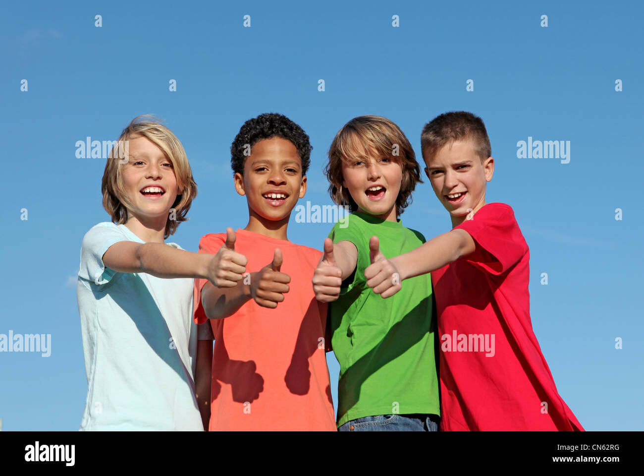 group of divderse kids at summer camp with thumbs up - Stock Image