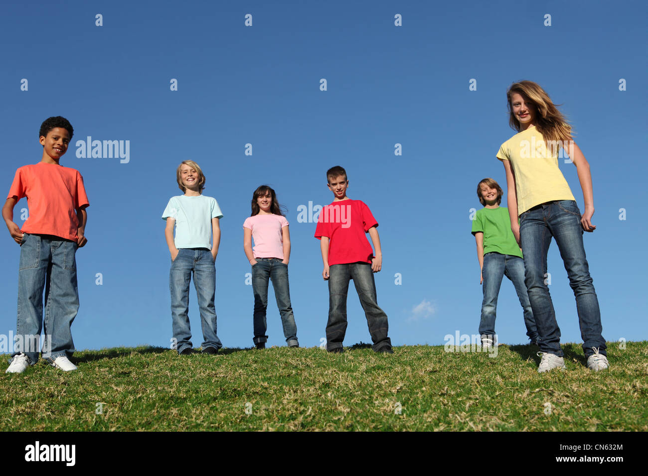 group of diverse kids in blank t shirts - Stock Image