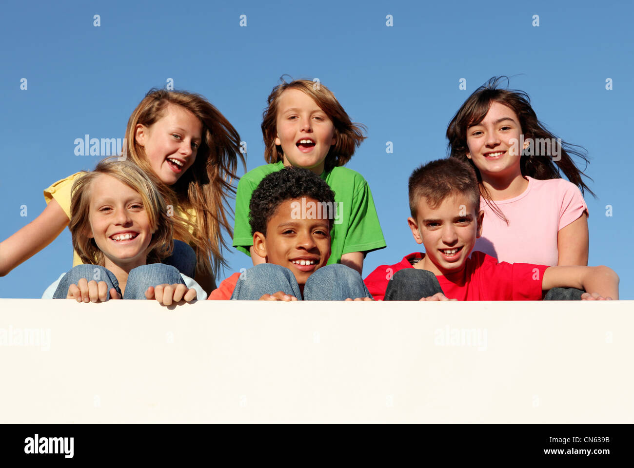group of diverse kids or children with blank sign or board - Stock Image