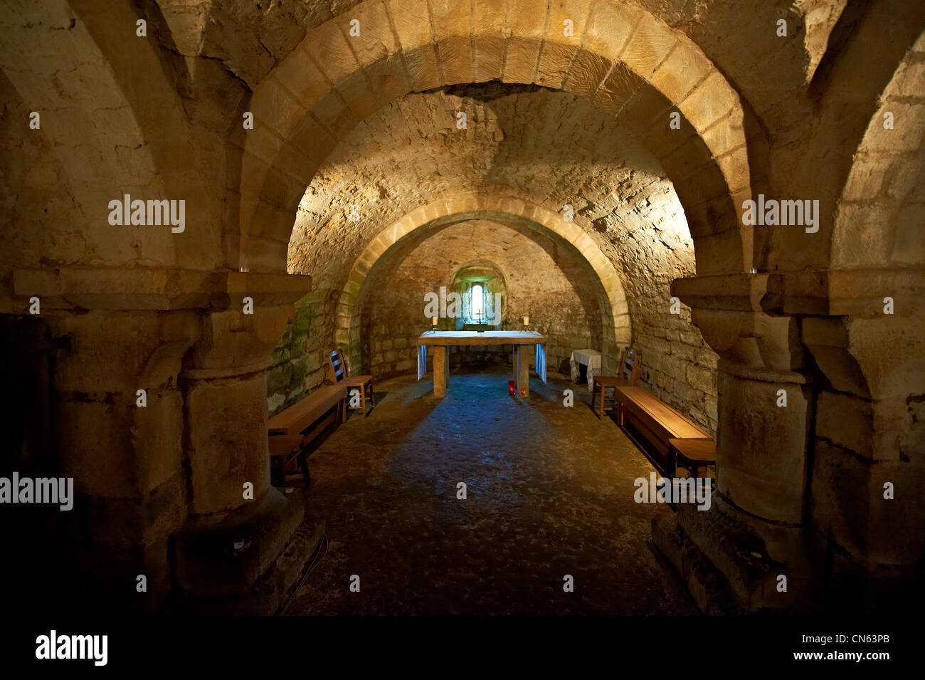 The naive & two isles of the 12th century Norman crypt of Lstingham Church. North Yorkshire Moors National Park. - Stock Image