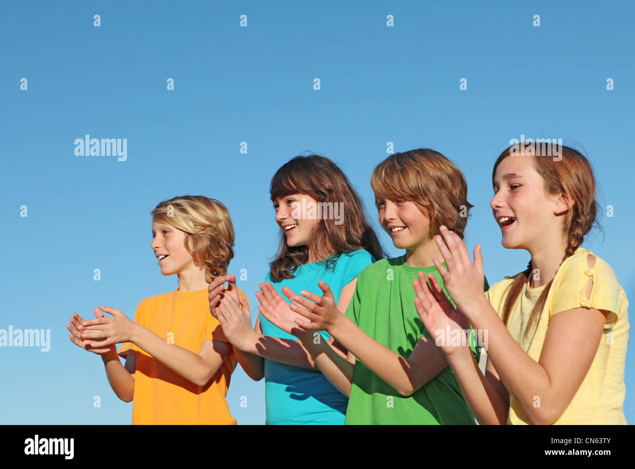 group of kids, children, or supporters clapping - Stock Image