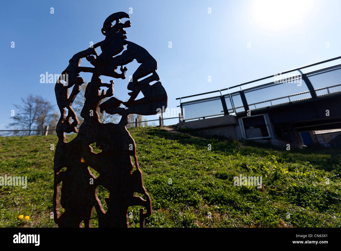 A sculpture of Tottenham & England footballer Ledley King near Meath Bridge, Mile End Park, by the Regent's - Stock Image