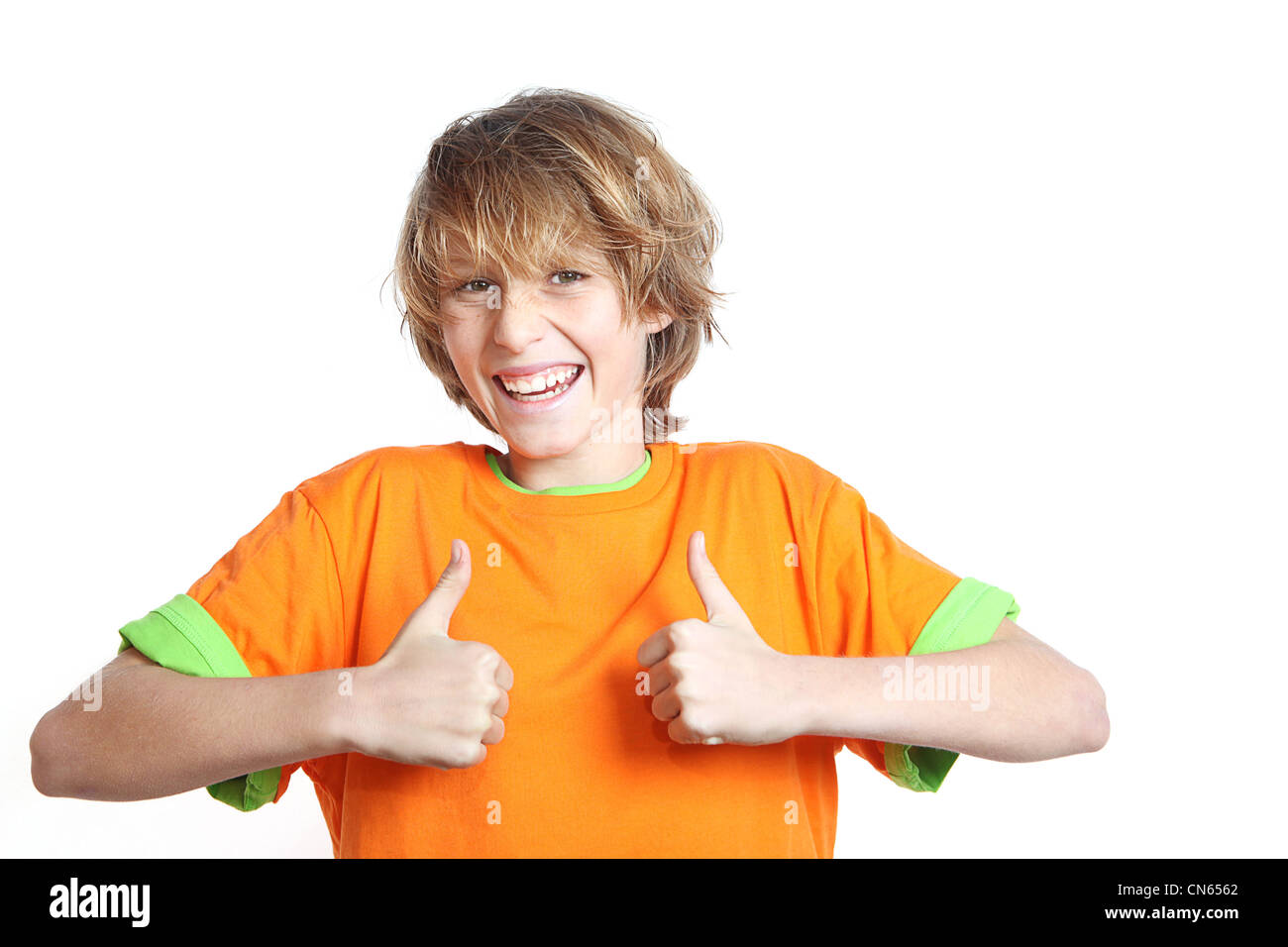 happy child with thumbs up for success Stock Photo