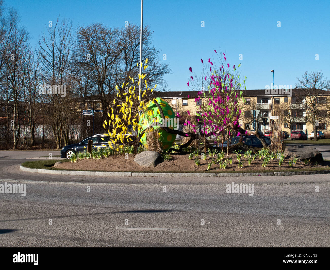 Easter feathers decorations at a roundabout in Sweden - Stock Image