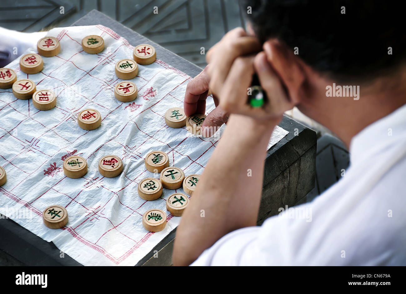 Man playing the game of Xiangqi, or Chinese Chess, China - Stock Image