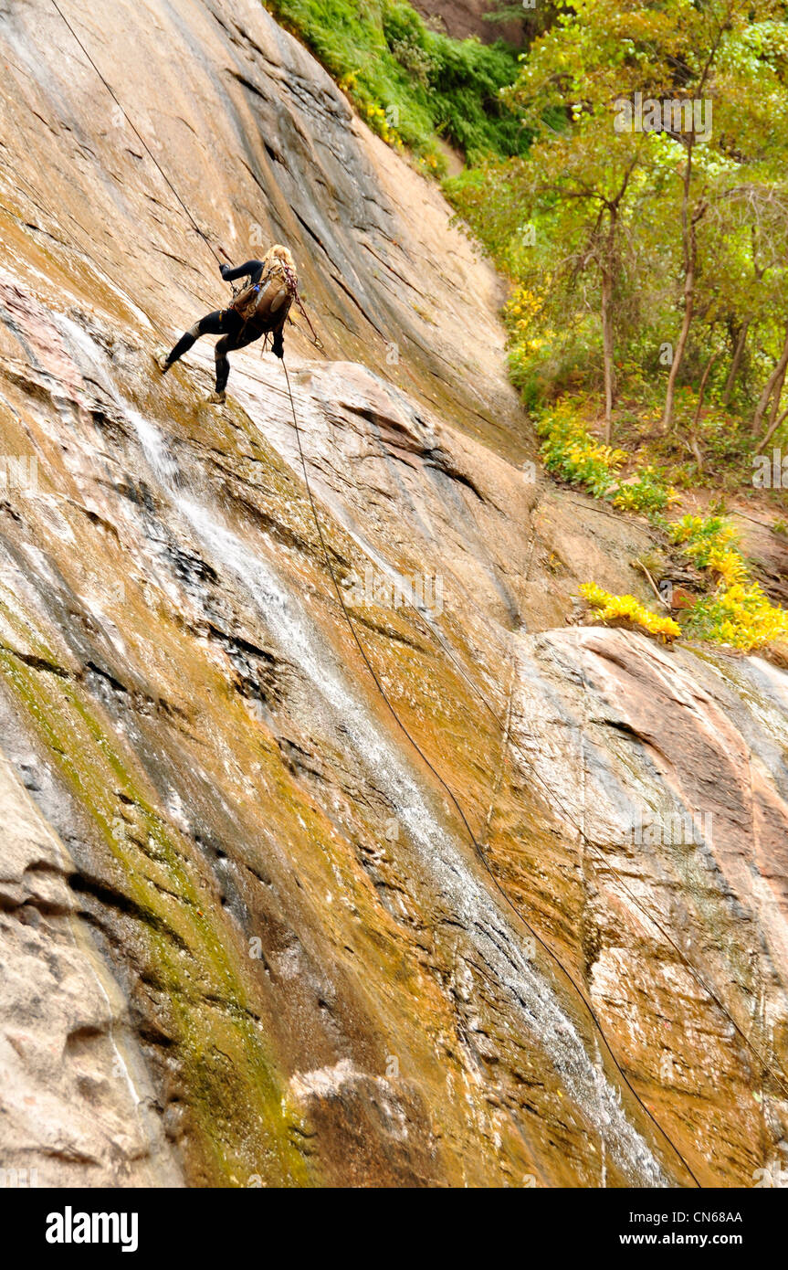 Rappelling into Utah's Zion Canyon. - Stock Image