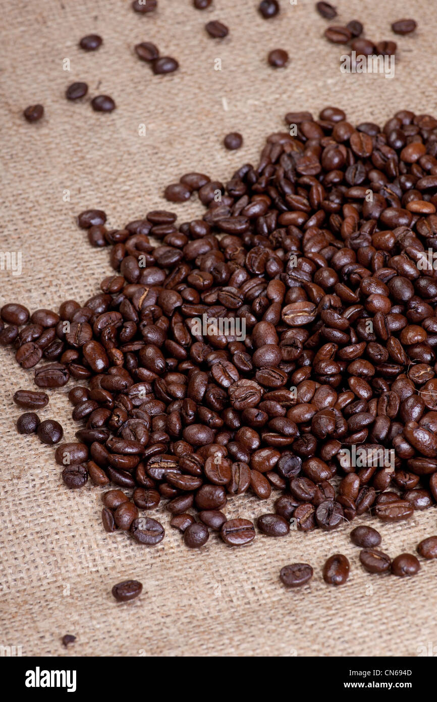 Coffee beans on hessian sack - Stock Image