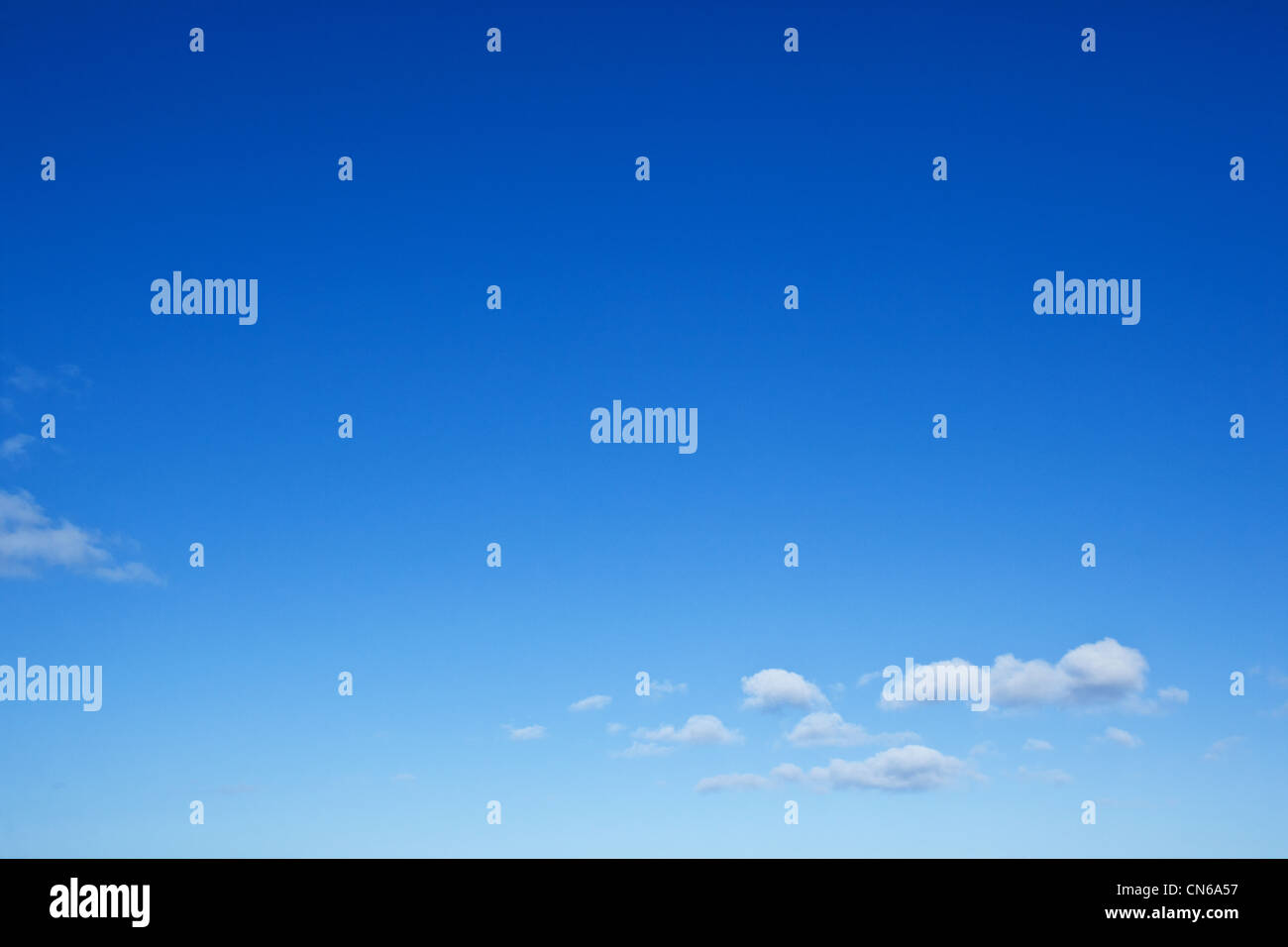 Blue Sky with small clouds - Stock Image