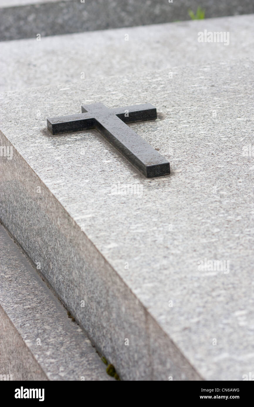 Christian grave with cross on the vault - Stock Image
