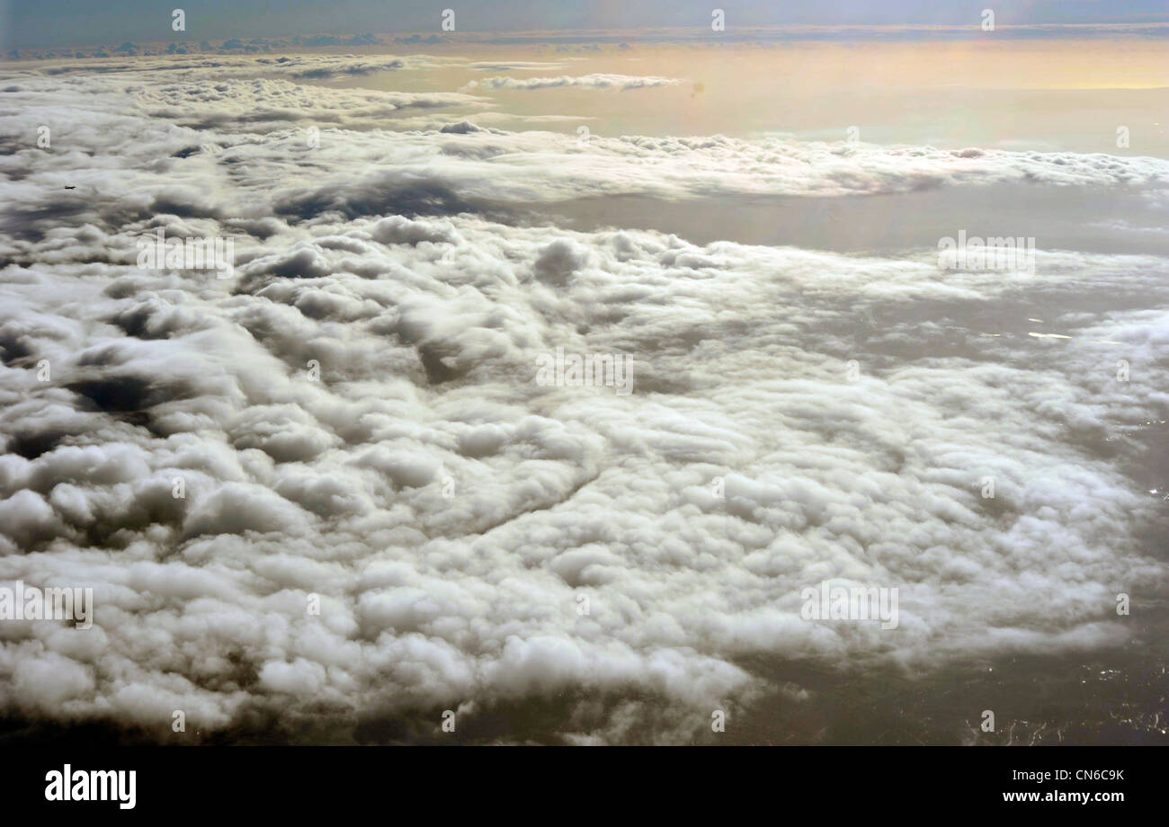 Looking down at some beautiful, white, fluffy clouds - Stock Image