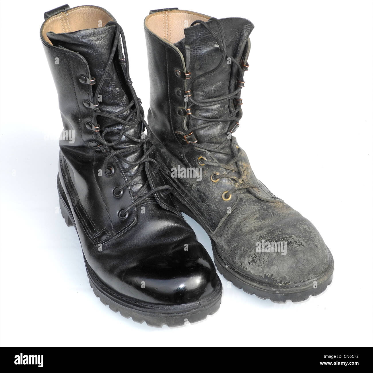 A well cared for military boot - army polished - with a well worn one Stock Photo