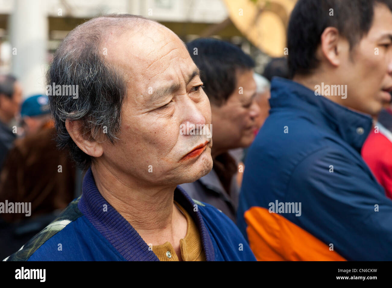 Taiwanese man chewing betel nut in Mangka Park Taipei Taiwan. JMH5678 - Stock Image