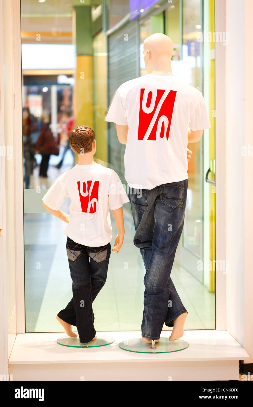 Two dummies in symbolizing discount shirts shot from behind - Stock Image