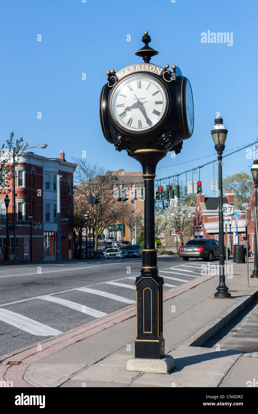 A 4-faced pedestal clock in Harrison, New York. - Stock Image