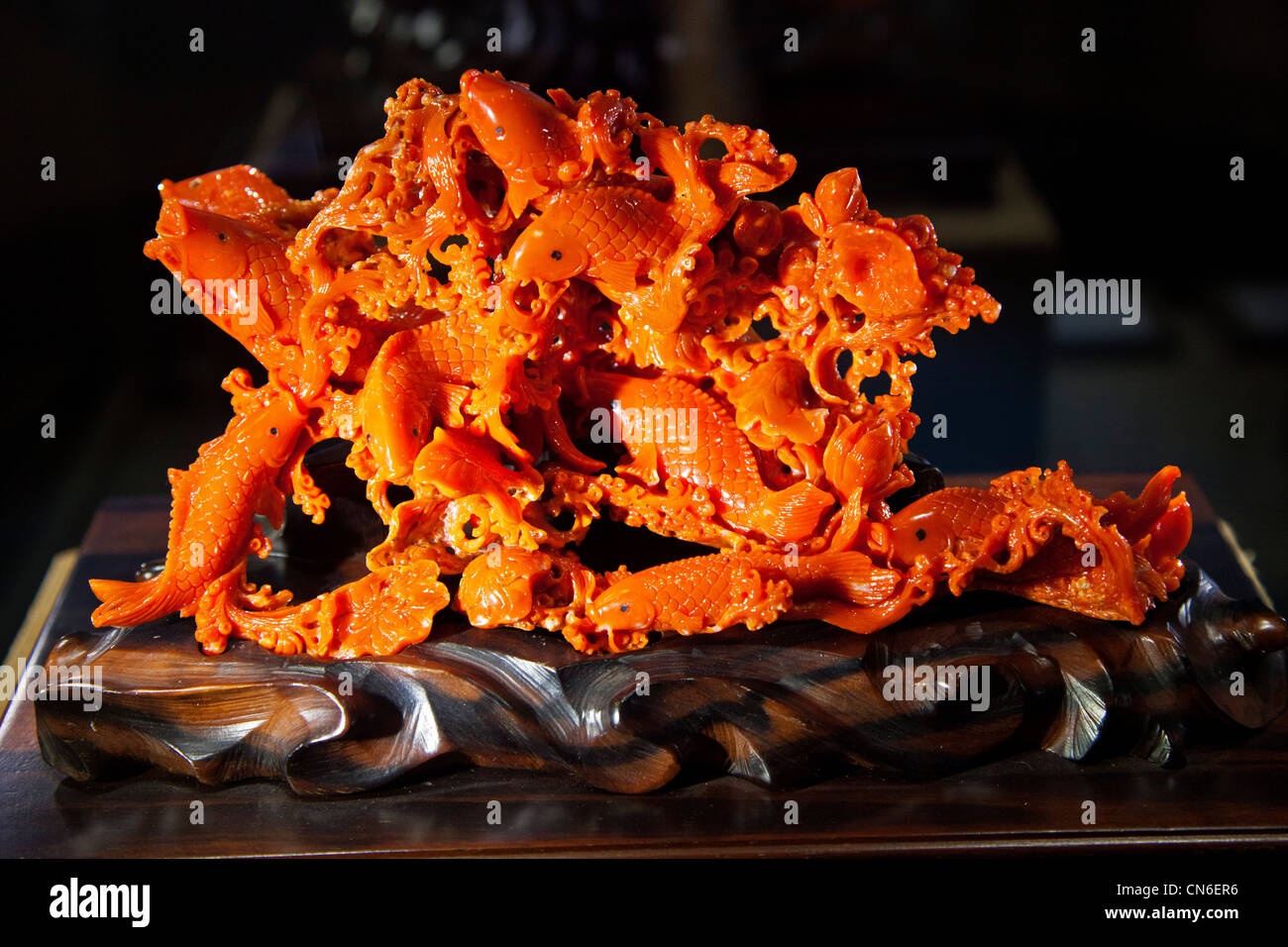 Carved and polished gemstone momo coral corallium japonicum in Taipei Taiwan. JMH5740 - Stock Image