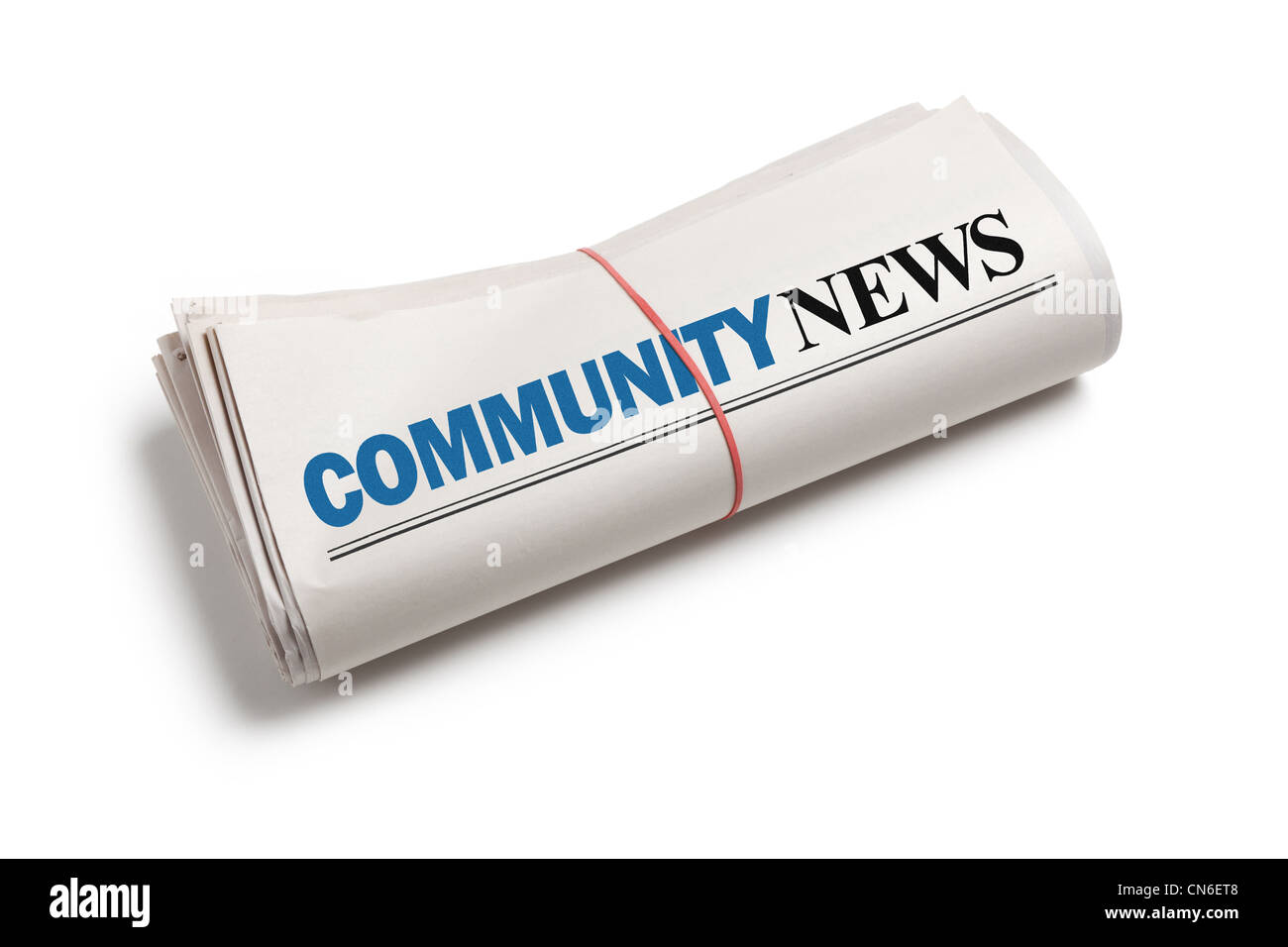 Community News, Newspaper roll with white background - Stock Image