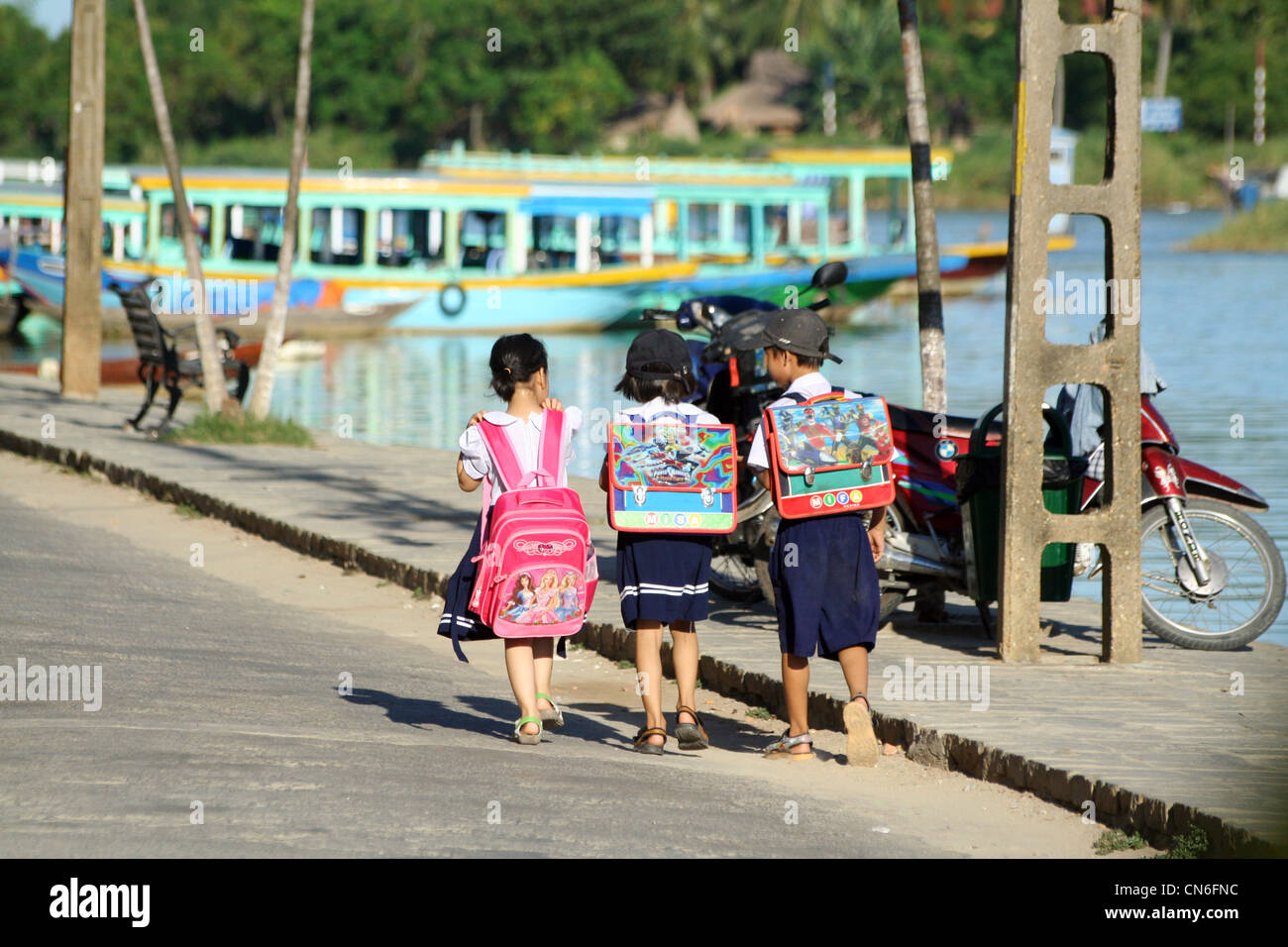 Vietnamese school children on their way home in Hoi An, Vietnam - Stock Image