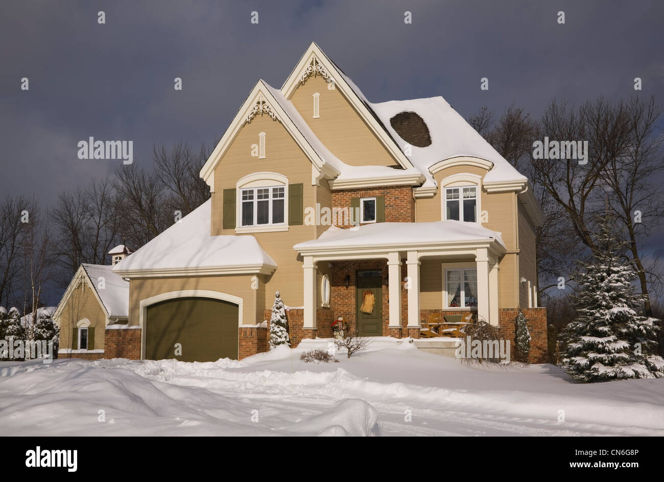 Snow car garage stock photos snow car garage stock images alamy cottage style home with one car garage in winter laval quebec solutioingenieria Images