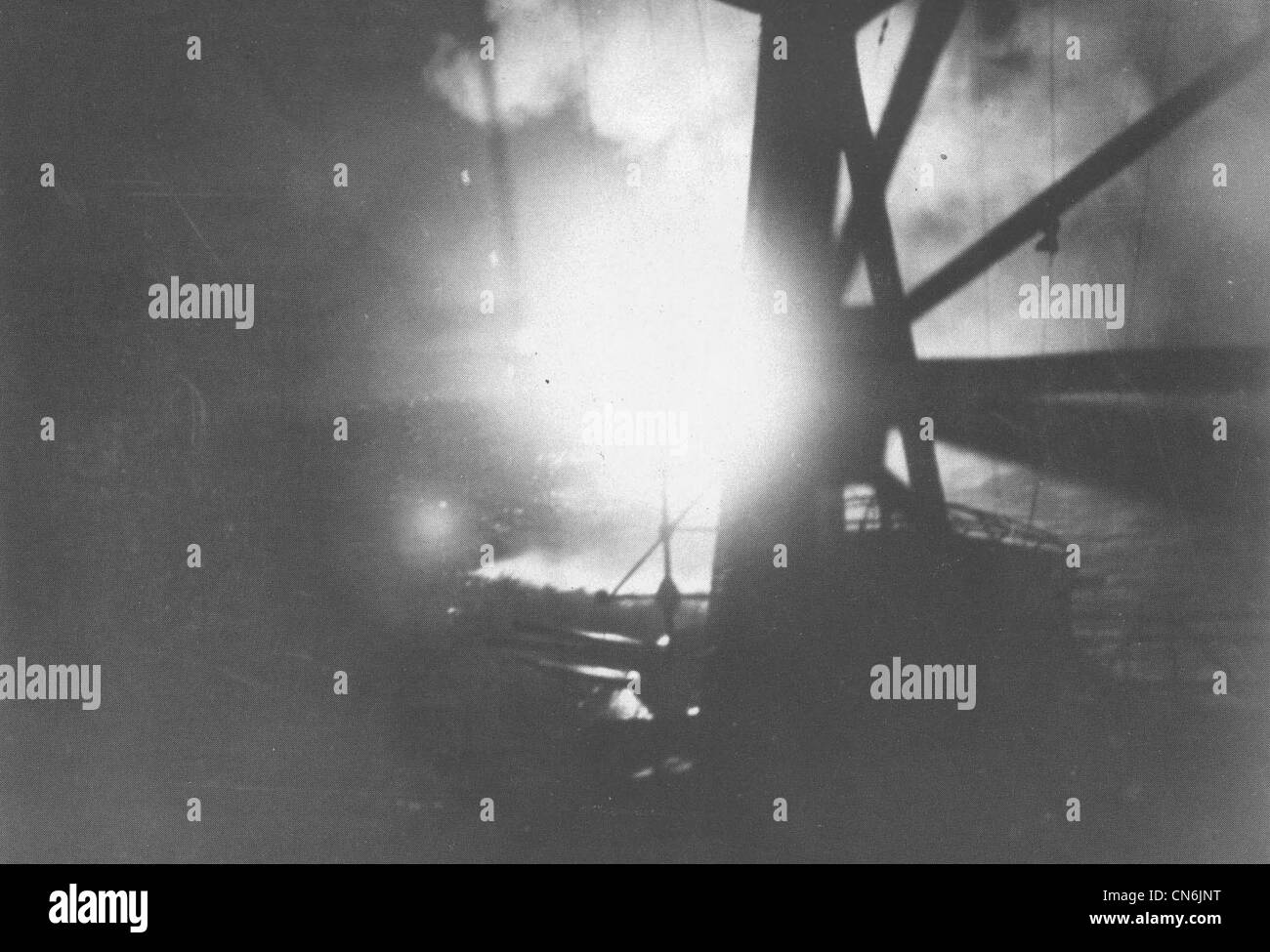 Japanese cruiser Chokai of the battle with the Allied 'southern' force as aerial flares illuminate the Allied - Stock Image