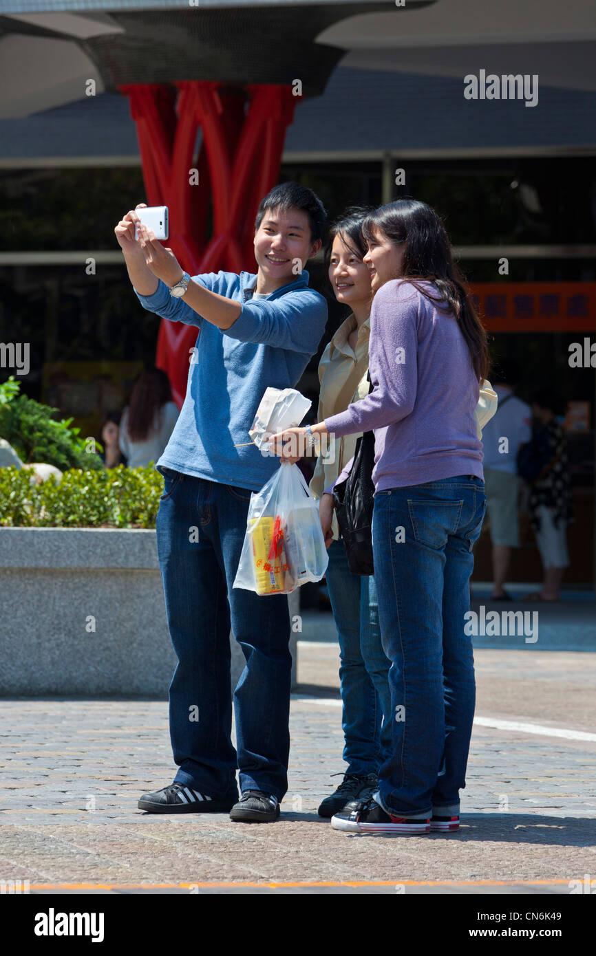 Selfie self portrait of three people at Sun Moon Lake, Taiwan. JMH5824 - Stock Image