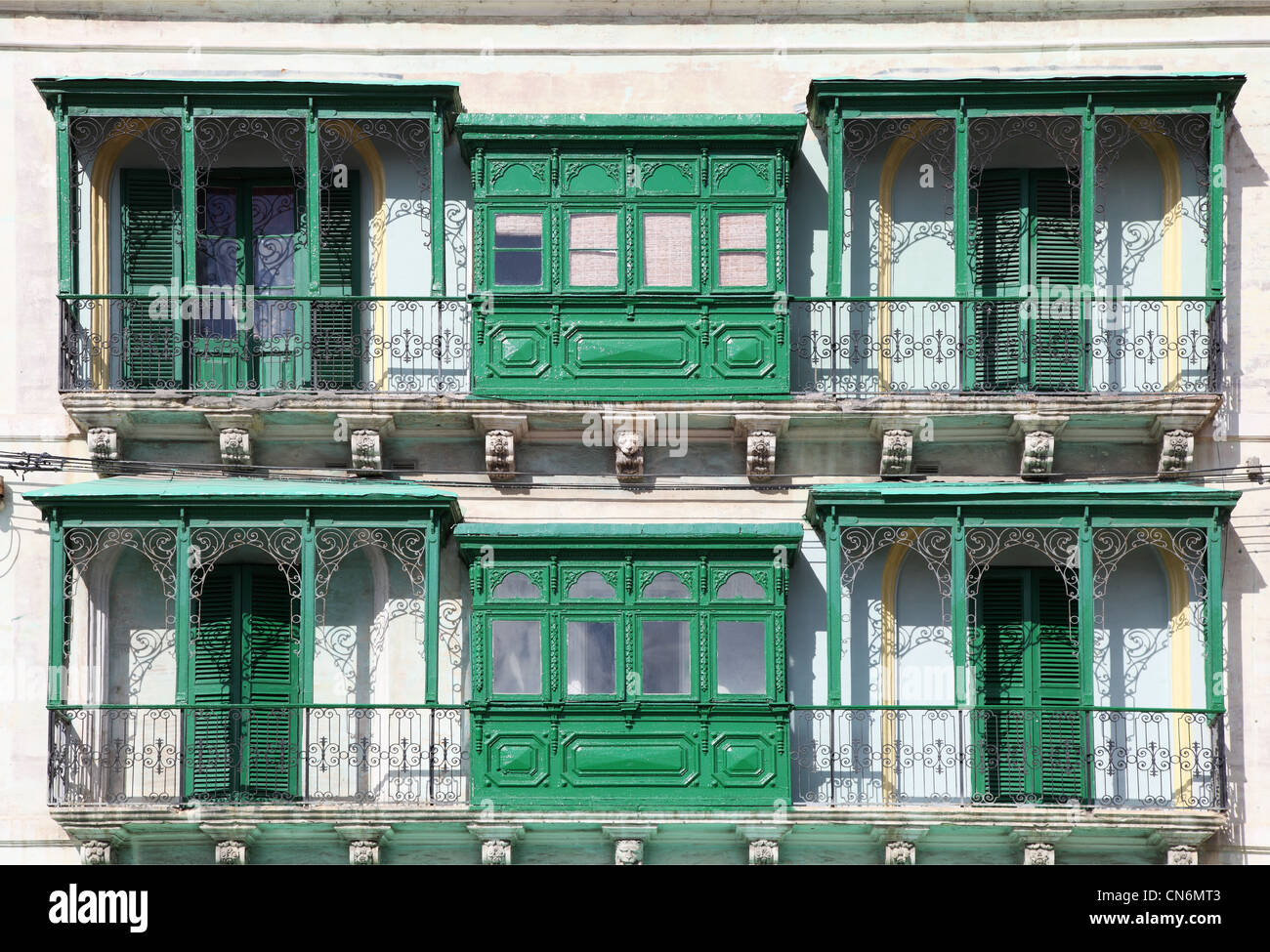 Traditional bay windows and balconies on a town house in Kalkara, Malta - Stock Image