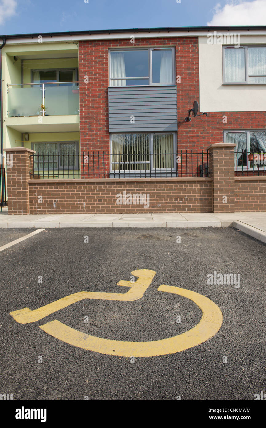 New build social housing with disabled parking bay - Stock Image