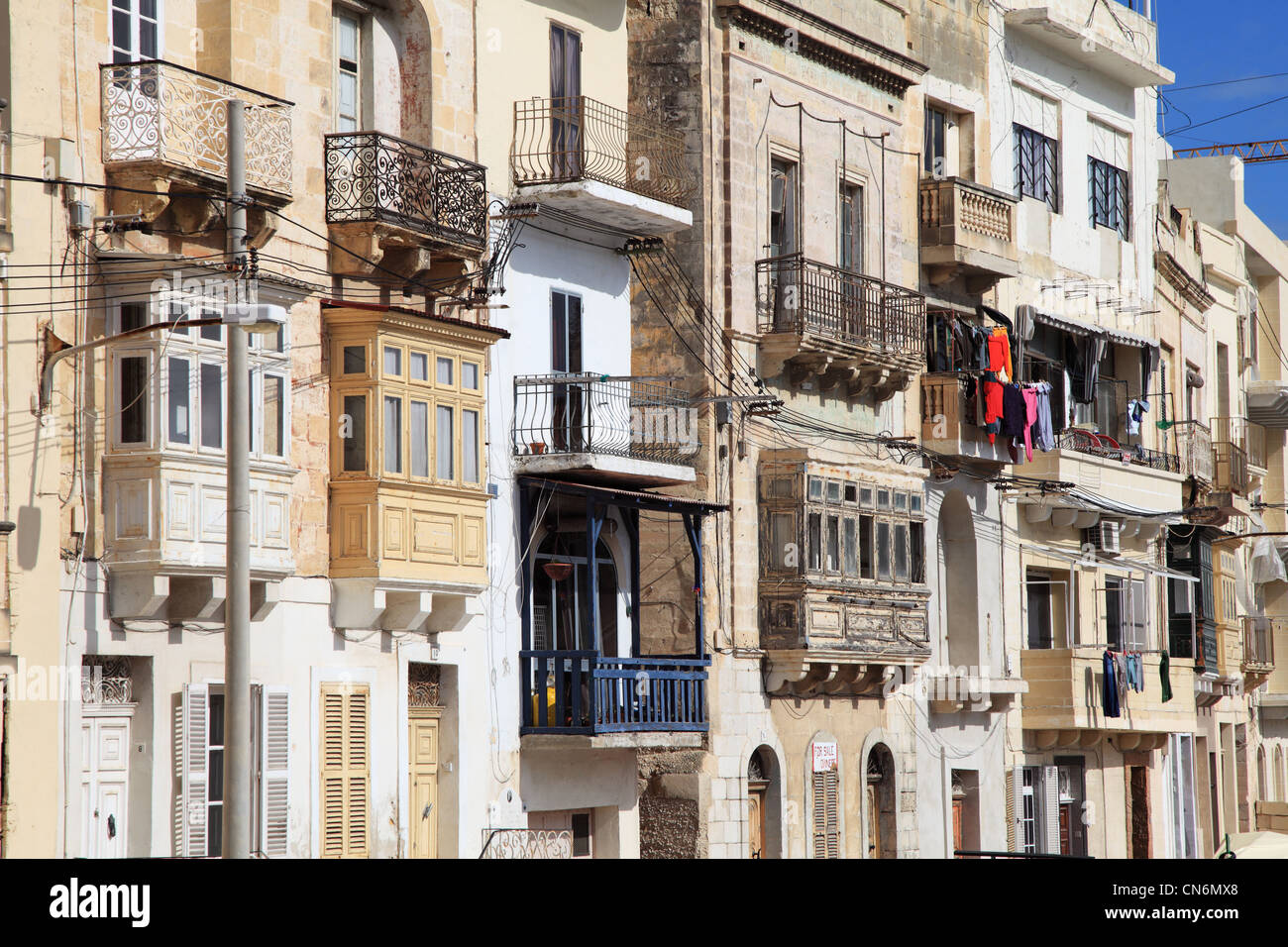 Collection of traditional Maltese town houses with balconies and bay windows, Kalkara, Malta, Europe - Stock Image