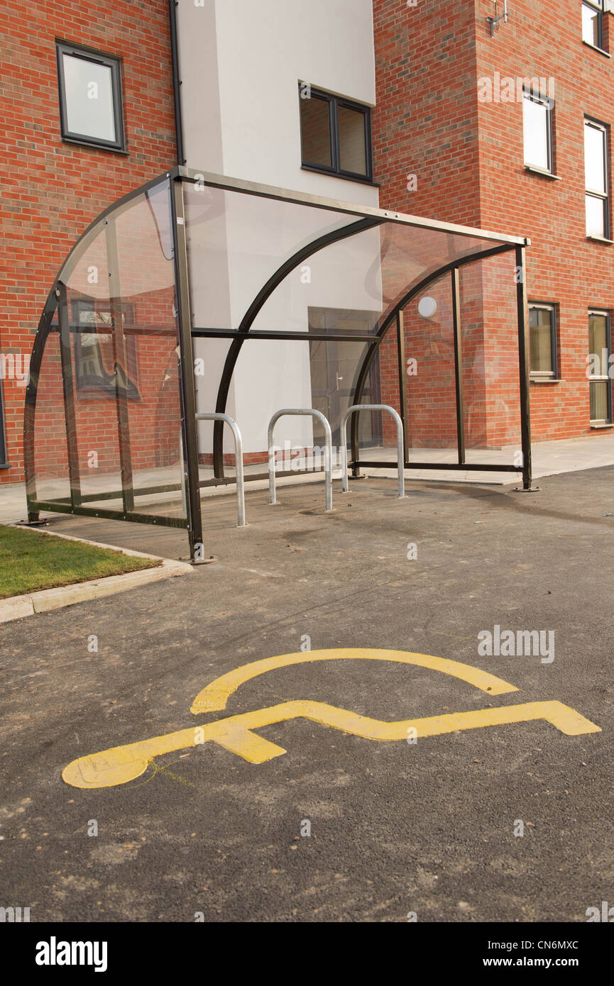 New build social housing disabled parking bay and cycle shelter - Stock Image