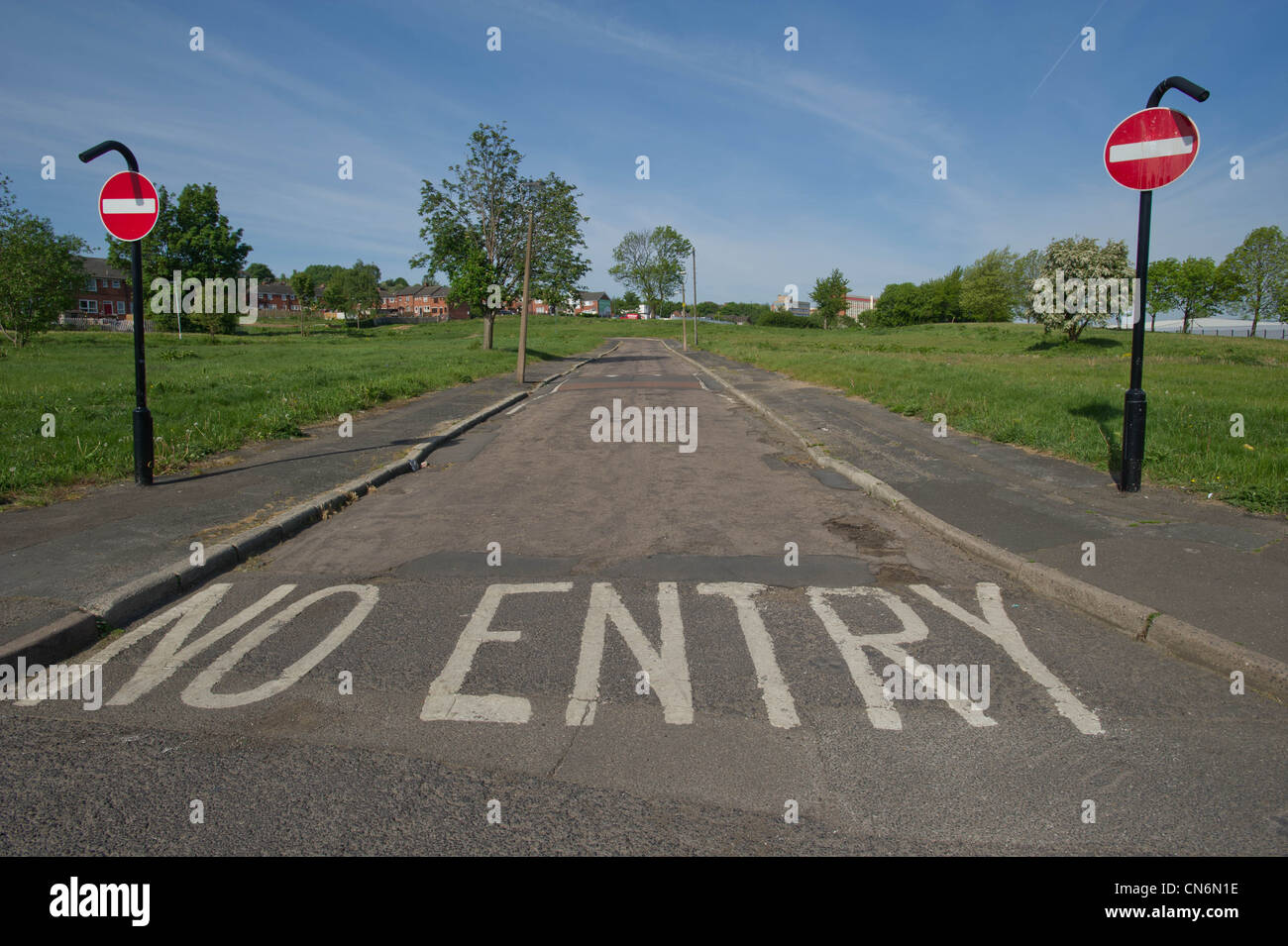 No Entry road markings and signs on a sink estate in Sheffield - Stock Image