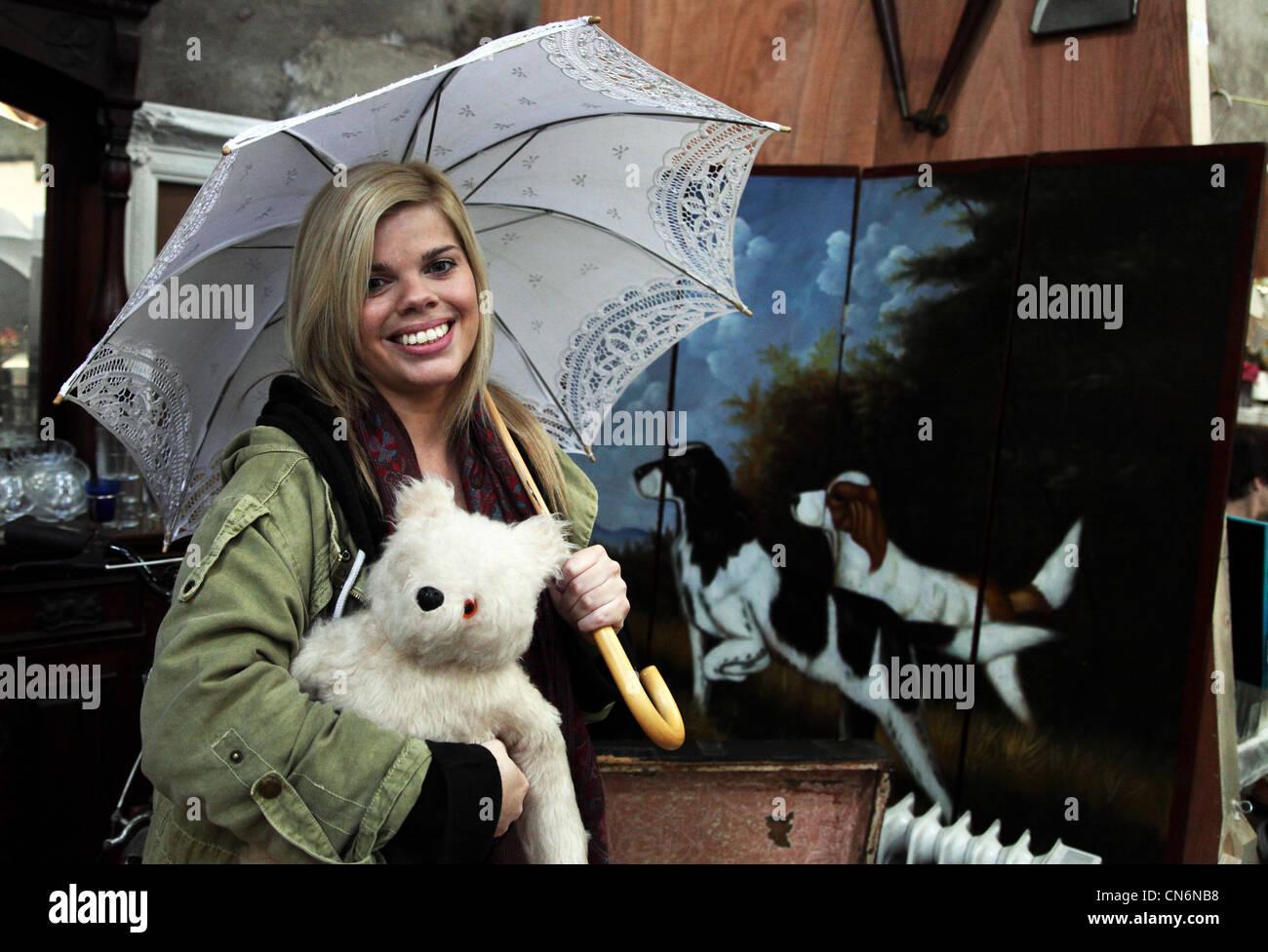 Sarah Lennon with a parasol and Paddington Bear at Merchants Yard car boot sale, Merchants Yard, Dublin, Ireland - Stock Image