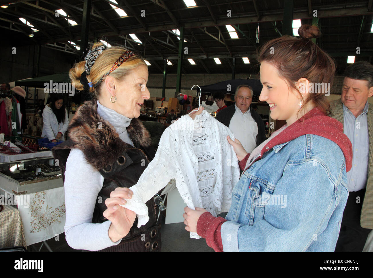 Jeanette makes a sale at the Merchants Yard Car Boot Sale, Dublin, Ireland - Stock Image