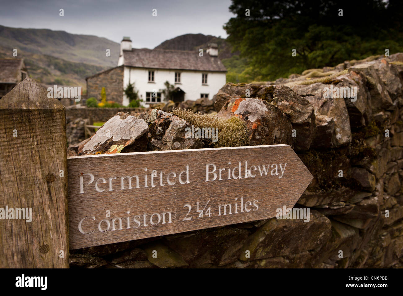 UK, Cumbria, Lake District, permitted bridleway wooden footpath signpost to Coniston at Yew Tree Farm - Stock Image