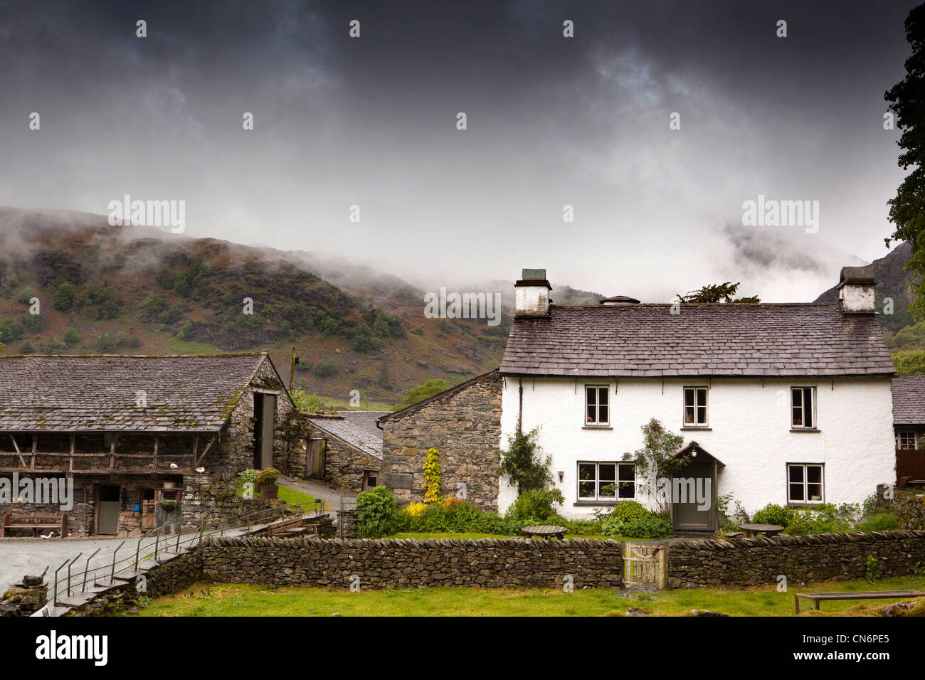 UK, Cumbria, Coniston, rain cloud approaching Yew Tree Farm, from Old Man of Coniston - Stock Image