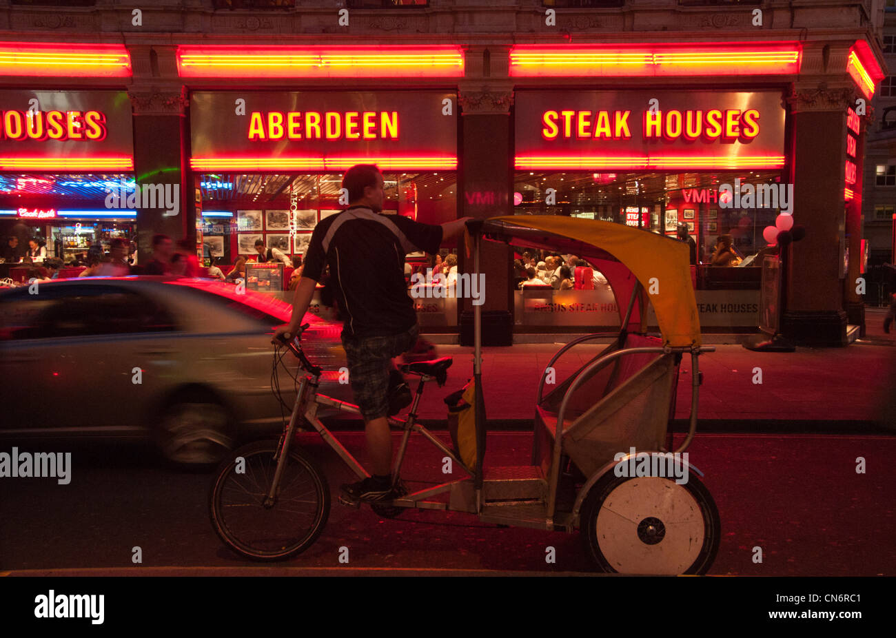 Rickshaw and Angus Steak House, Leicester Square, London, UK. - Stock Image