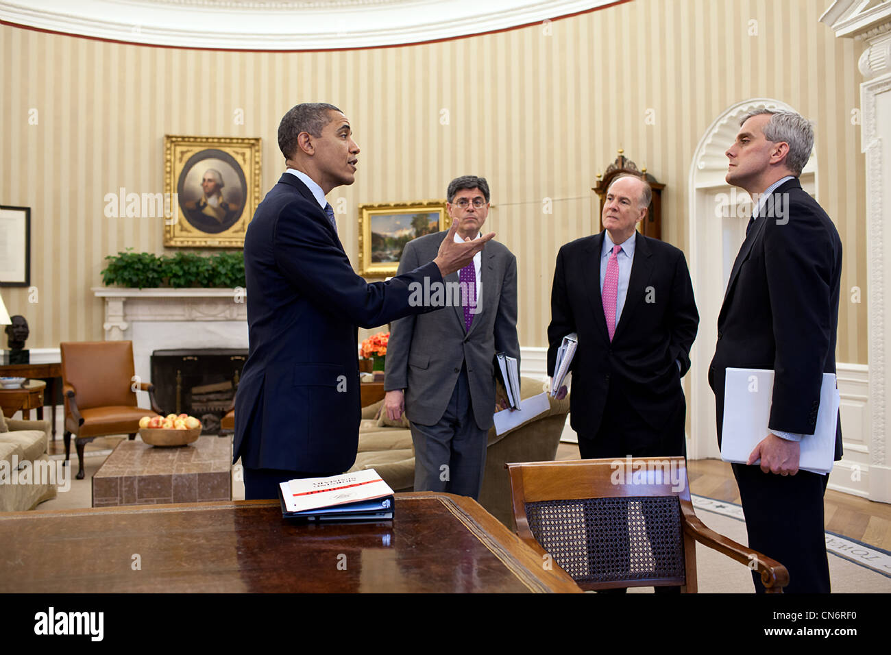 President Barack Obama talks with Chief of Staff Jack Lew, National Security Advisor Tom Donilon, and Deputy National - Stock Image